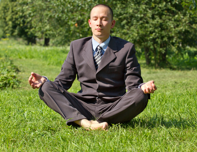 Businessman Meditating Outdoors