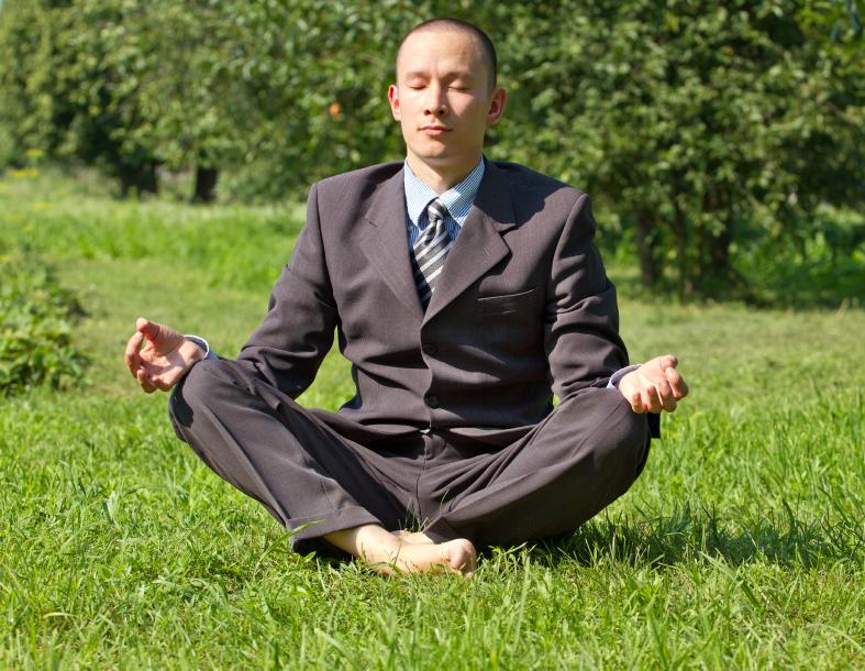 Businessman Meditating Outdoors