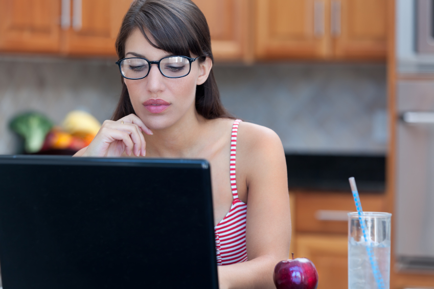 Woman in glasses using laptop computer