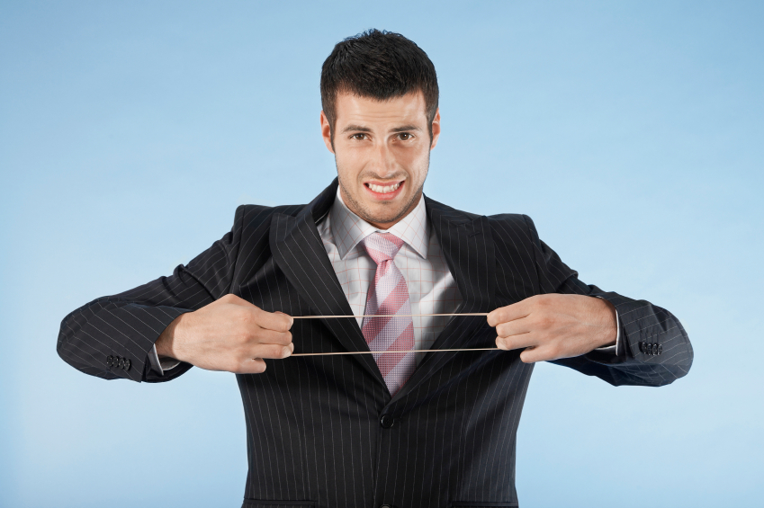 Businessman Stretching Rubber Band