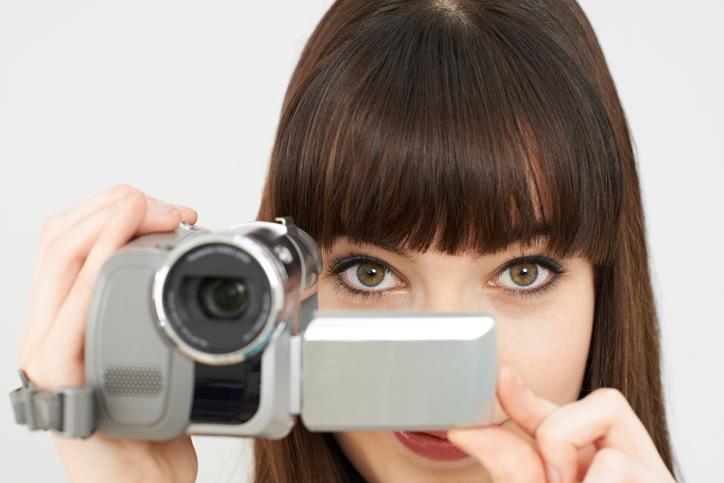 Woman Recording On Portable Video Camera